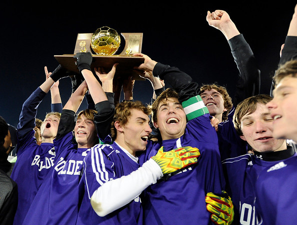 Boulder High School's Mason Douillard, center, hugs teammate Cory Waltrip while celebrating after winning the boys Class 5A State Championship against Smoky Hill High School on Monday, Nov. 12, at Dick's Sporting Goods Park in Commerce City. Boulder won the game 3-1.<br /> Jeremy Papasso/ Camera