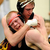 Skyline High School wrestler Josh Bechtold, top, draws blood from the lip of Fairview's Josh Gregory during a match at the Boulder Valley Invitational wrestling meet on Saturday, Jan. 8, at Niwot High School. Bechtold defeated Gregory.<br /> Jeremy Papasso/ Camera