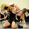 Niwot High School wrestler Nick Stager, right, tries to maintain control of Monarch's Jace Waldmann during a match at the Boulder Valley Invitational wrestling meet on Saturday, Jan. 8, at Niwot High School. Stager defeated Waldmann.<br /> Jeremy Papasso/ Camera