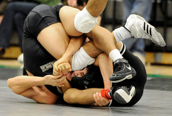 Monarch High School wrestler Christian Valentine fights to avoid the pin by Fairview's Chris Chavez during the Boulder Valley Invitational wrestling meet on Saturday, Jan. 8, at Niwot High School. Chavez defeated Valentine with a pin in the third period.<br /> Jeremy Papasso/ Camera