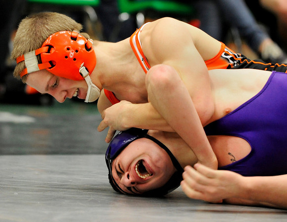 Erie High School wrestler Casey Crescentini, top, brings the pain to Boulder's Lance Padilla during the Boulder Valley Invitational wrestling meet on Saturday, Jan. 8, at Niwot High School. Crescentini defeated Padilla in points after three tough periods.<br /> Jeremy Papasso/ Camera