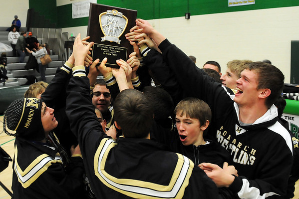 The Monarch High School wrestling team holds up the first place team trophy after winning the Boulder Valley Invitational wrestling meet on Saturday, Jan. 8, at Niwot High School.<br /> Jeremy Papasso/ Camera