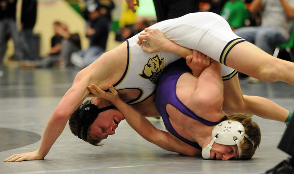 Caleb Downs, top, of Frederick, attempts to pin Connor Murtha of Boulder High at 119 pounds.<br /> Cliff Grassmick / January 9, 2010