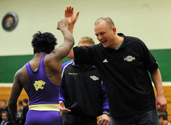 "Boulder High Wrestling coach Glenn Kingsley has a high five for Babalu Jones after his pin for a win at 103 pounds.<br /> For more wrestling photos, go to  <a href=""http://www.dailycamera.com"">http://www.dailycamera.com</a>.<br /> Cliff Grassmick / January 9, 2010"