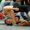 "Quinn McGehan, top, of Fairview, works Brandon Knudson of Silver Creek into a pin  at 125 pounds on Saturday.<br /> For more wrestling photos, go to  <a href=""http://www.dailycamera.com"">http://www.dailycamera.com</a>.<br /> Cliff Grassmick / January 9, 2010"