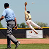 "Monarch's Ryan Norton leaps for the ball and misses during a baseball game against the Boulder Wells Fargo Advisors on Sunday, July 24, at Monarch High School in Louisville. Boulder defeated Monarch 13-9. For more photos of the game go to  <a href=""http://www.dailycamera.com"">http://www.dailycamera.com</a><br /> Jeremy Papasso/ Camera"