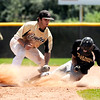 "Boulder's Loic Guegan slides into second base safely under the tag of Monarch's Alex Blazon during a baseball game against on Sunday, July 24, at Monarch High School in Louisville.  Boulder defeated Monarch 13-9. For more photos of the game go to  <a href=""http://www.dailycamera.com"">http://www.dailycamera.com</a><br /> Jeremy Papasso/ Camera"