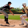 "Boulder Wells Fargo Advisor Levi Chandler, left, tags out Monarch's Brian Wood during a baseball game on Sunday, July 24, at Monarch High School in Louisville. Boulder defeated Monarch 13-9. For more photos of the game go to  <a href=""http://www.dailycamera.com"">http://www.dailycamera.com</a><br /> Jeremy Papasso/ Camera"