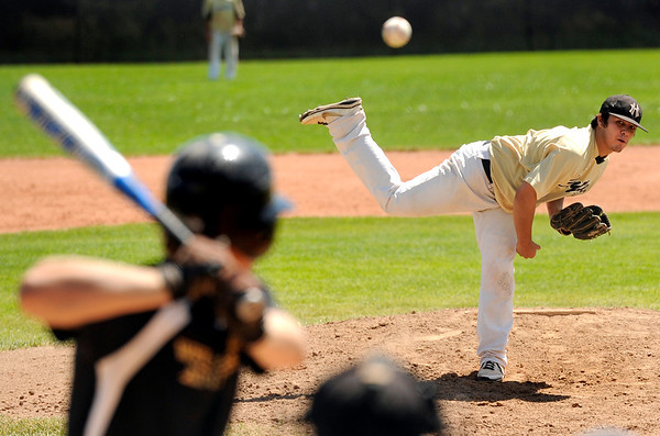 "Monarch's Alex Blazon throws some heat during a baseball game against the Boulder Wells Fargo Advisors on Sunday, July 24, at Monarch High School in Louisville. Boulder defeated Monarch 13-9. For more photos of the game go to  <a href=""http://www.dailycamera.com"">http://www.dailycamera.com</a><br /> Jeremy Papasso/ Camera"