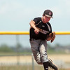 """Boulder Wells Fargo Advisor Levi Chandler makes a play at first base during a baseball game against Monarch's Legion A team on Sunday, July 24, at Monarch High School in Louisville. For more photos of the game go to  <a href=""""http://www.dailycamera.com"""">http://www.dailycamera.com</a><br /> Jeremy Papasso/ Camera"""