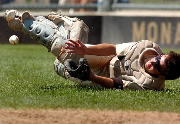 "Monarch catcher Greg Przedpelski drops a foul ball during a baseball game against the Boulder Wells Fargo Advisors on Sunday, July 24, at Monarch High School in Louisville. Boulder defeated Monarch 13-9. For more photos of the game go to  <a href=""http://www.dailycamera.com"">http://www.dailycamera.com</a><br /> Jeremy Papasso/ Camera"