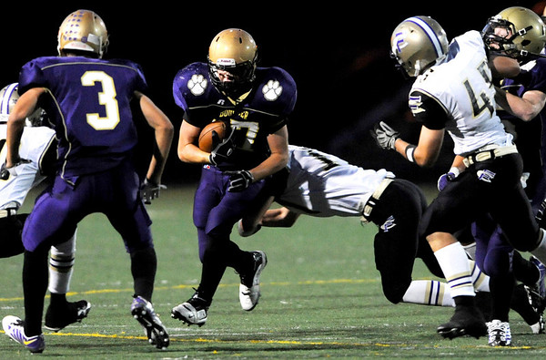 Boulder's Ethan Baker (17) misses Fort Collins'  Merrick Kelley (17) dive during the game at Recht Field at Boulder High School in Boulder Thursday, Sept. 17, 2009.<br /> <br />  DAILY CAMERA/ Kasia Broussalian