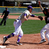"""Boulder High's Ray Feisal, #11, tags Prairie View's Sergio Morend,#4, out at first base on April 7, 2012, Boulder.<br /> For more photos visit  <a href=""""http://www.dailycamera.com"""">http://www.dailycamera.com</a><br /> Photo by Derek Broussard"""