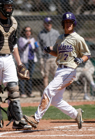 "Boulder High's Connor Stowe, #7, crosses over home base to score a run on April 7, 2012, Boulder.<br /> For more photos visit  <a href=""http://www.dailycamera.com"">http://www.dailycamera.com</a><br /> Photo by Derek Broussard"