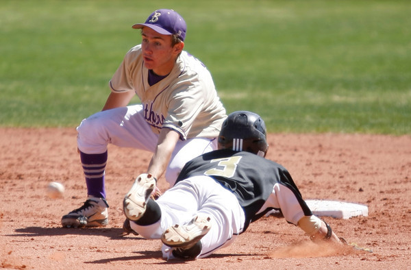 "Boulder High's Francis Ianzano, #2, tags Prairie View's  Caleb Dameron, #3, out at second base on April 7, 2012, Boulder.<br /> For more photos visit  <a href=""http://www.dailycamera.com"">http://www.dailycamera.com</a><br /> Photo by Derek Broussard"