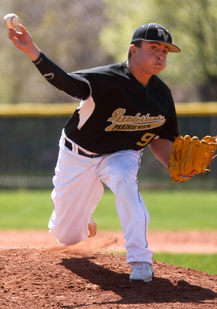"""Prairie View High School's  Dominic Cardenas, #9, pitches during the third inning of the game versus Boulder High on April 7, 2012, Boulder.<br /> For more photos visit  <a href=""""http://www.dailycamera.com"""">http://www.dailycamera.com</a><br /> Photo by Derek Broussard"""