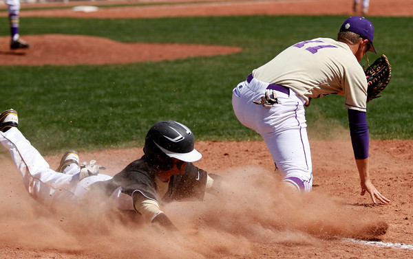 "Prairie View's Kyle Killen,#5, slides into first base past Boulder High's Ray Feisal, #11, on April 7, 2012, Boulder.<br /> For more photos visit  <a href=""http://www.dailycamera.com"">http://www.dailycamera.com</a><br /> Photo by Derek Broussard"