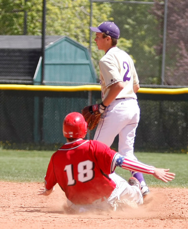 "Jack Madden,#18, of Fairview, slides safe into second base before Boulder's Francis Lanzano, #2, can tag him out on April, 21, 2012, in Boulder.<br /> Photo by Derek Broussard<br /> For more photos visit  <a href=""http://www.dailycamera.com"">http://www.dailycamera.com</a>"