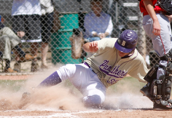 "Alex Denton, #33, of Boulder High, slides safe at home base on April, 21, 2012, in Boulder.<br /> Photo by Derek Broussard<br /> For more photos visit  <a href=""http://www.dailycamera.com"">http://www.dailycamera.com</a>"