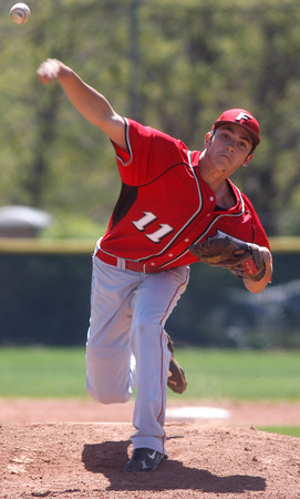 "Fairview's Will Stororman, #11, pitches during the second inning of the game versus Boulder on April, 21, 2012, in Boulder.<br /> Photo by Derek Broussard<br /> For more photos visit  <a href=""http://www.dailycamera.com"">http://www.dailycamera.com</a>"