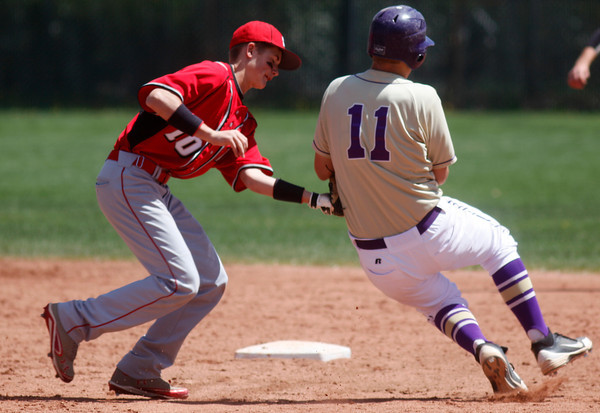 "Johnny Feauto, #10, of Fairview, tags out Boulder's Ray Feigal, #11 at second base on, April, 21, 2012, in Boulder.<br /> Photo by Derek Broussard<br /> For more photos visit  <a href=""http://www.dailycamera.com"">http://www.dailycamera.com</a>"
