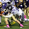 """Boulder High School's Abel Brown is taken down by Matt Evans during a football game against Arvada West High School on Friday, Oct. 28 at Recht Field in Boulder. For more photos of the game go to  <a href=""""http://www.dailycamera.com"""">http://www.dailycamera.com</a><br /> Jeremy Papasso/ Camera"""