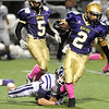 "Boulder High School's Luis Escobar shakes a tackle from Nick Beyette during a football game against Arvada West High School on Friday, Oct. 28 at Recht Field in Boulder. For more photos of the game go to  <a href=""http://www.dailycamera.com"">http://www.dailycamera.com</a><br /> Jeremy Papasso/ Camera"