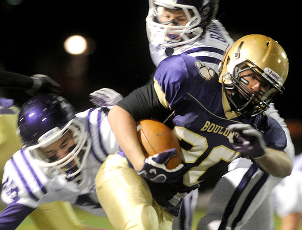 """Boulder High School's Abel Brown rushes through the defensive line during a football game against Arvada West High School on Friday, Oct. 28 at Recht Field in Boulder. For more photos of the game go to  <a href=""""http://www.dailycamera.com"""">http://www.dailycamera.com</a><br /> Jeremy Papasso/ Camera"""