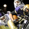 "Boulder High School's Abel Brown rushes through the defensive line during a football game against Arvada West High School on Friday, Oct. 28 at Recht Field in Boulder. For more photos of the game go to  <a href=""http://www.dailycamera.com"">http://www.dailycamera.com</a><br /> Jeremy Papasso/ Camera"