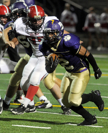 "Boulder High School's Luis Escobar rushes the ball past Koby Nation during a game against Brighton High School on Thursday, Sept. 20, at Recht Field in Boulder. For more photos of the game go to  <a href=""http://www.dailycamera.comJeremy"">http://www.dailycamera.comJeremy</a> Papasso/ Camera"