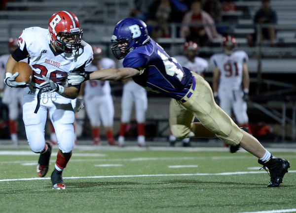 "Boulder High School's Logan Bock misses a tackle on Nathan Morales during a game against Brighton High School on Thursday, Sept. 20, at Recht Field in Boulder. For more photos of the game go to  <a href=""http://www.dailycamera.comJeremy"">http://www.dailycamera.comJeremy</a> Papasso/ Camera"