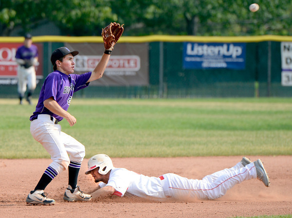 "Boulder's Francis Lanzano misses the tag on Brighton's Donte Archuleta on Monday, July 2, during a baseball game against Brighton at the Scott Carpenter Park baseball field in Boulder. For more photos of the game go to  <a href=""http://www.dailycamera.com"">http://www.dailycamera.com</a><br /> Jeremy Papasso/ Camera"
