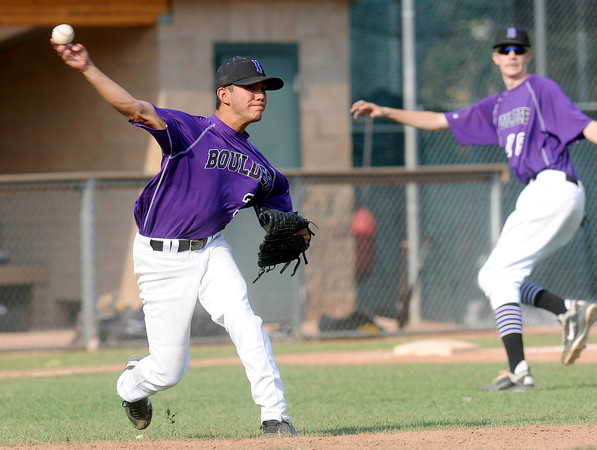 """Boulder pitcher Cisco Medina snags a ground ball and makes an out at first base on Monday, July 2, during a baseball game against Brighton at the Scott Carpenter Park baseball field in Boulder. For more photos of the game go to  <a href=""""http://www.dailycamera.com"""">http://www.dailycamera.com</a><br /> Jeremy Papasso/ Camera"""