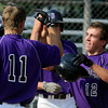 "Boulder's Levy Chandler, at right, is congratulated by his teammates after hitting a grand slam on Monday, July 2, during a baseball game against Brighton at the Scott Carpenter Park baseball field in Boulder. For more photos of the game go to  <a href=""http://www.dailycamera.com"">http://www.dailycamera.com</a><br /> Jeremy Papasso/ Camera"