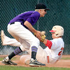 "Boulder's Austin Blessing tags out Brighton's Jason Adkins at third base on Monday, July 2, during a baseball game against Brighton at the Scott Carpenter Park baseball field in Boulder. For more photos of the game go to  <a href=""http://www.dailycamera.com"">http://www.dailycamera.com</a><br /> Jeremy Papasso/ Camera"