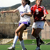 "Centaurus High School junior Anna Rinaldi heads the ball over Boulder's Kate Vann during a soccer game against Centaurus High School on Saturday, April 2, at Recht Field in Boulder. Boulder defeated Centaurus 2-0. For more photos go to  <a href=""http://www.dailycamera.com"">http://www.dailycamera.com</a><br /> Jeremy Papasso/ Camera"