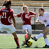 "Boulder High School's Kate Hebein gets her pass blocked by Centaurus junior Kelly Turcotte during a soccer game against Centaurus High School on Saturday, April 2, at Recht Field in Boulder. Boulder defeated Centaurus 2-0. For more photos go to  <a href=""http://www.dailycamera.com"">http://www.dailycamera.com</a><br /> Jeremy Papasso/ Camera"