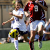 "Boulder High School's Sarah Radzihovsky dribbles the ball past Centaurus junior Anna Rinaldi during a soccer game against Centaurus High School on Saturday, April 2, at Recht Field in Boulder. Boulder defeated Centaurus 2-0. For more photos go to  <a href=""http://www.dailycamera.com"">http://www.dailycamera.com</a><br /> Jeremy Papasso/ Camera"
