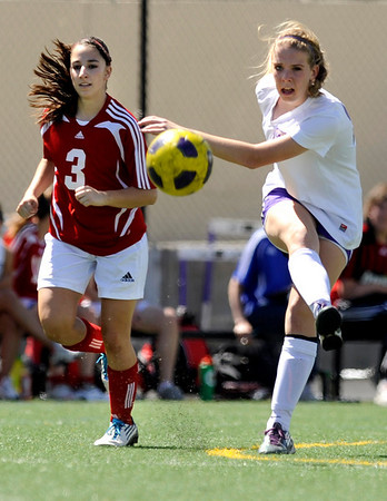 """Boulder High School's Abby Burridge passes the ball to a teammate during a soccer game against Centaurus High School on Saturday, April 2, at Recht Field in Boulder. Boulder defeated Centaurus 2-0. For more photos go to  <a href=""""http://www.dailycamera.com"""">http://www.dailycamera.com</a><br /> Jeremy Papasso/ Camera"""