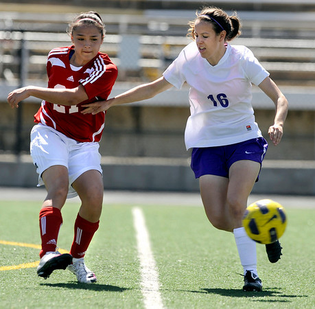 Boulder High School's Kate Hebein tries to block a pass from Centaurus junior Maurissa Ortega during a soccer game against Centaurus High School on Saturday, April 2, at Recht Field in Boulder.<br /> Jeremy Papasso/ Camera