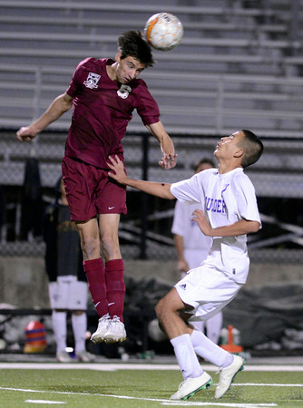 "Boulder High School's Javier Castruita watches as Evan Eshleman heads the ball during a playoff game against Chatfield High School on Monday, Oct. 29, at Recht Field in Boulder. Boulder won the game 3-2. For more photos of the game go to  <a href=""http://www.dailycamera.com"">http://www.dailycamera.com</a><br /> Jeremy Papasso/ Camera"