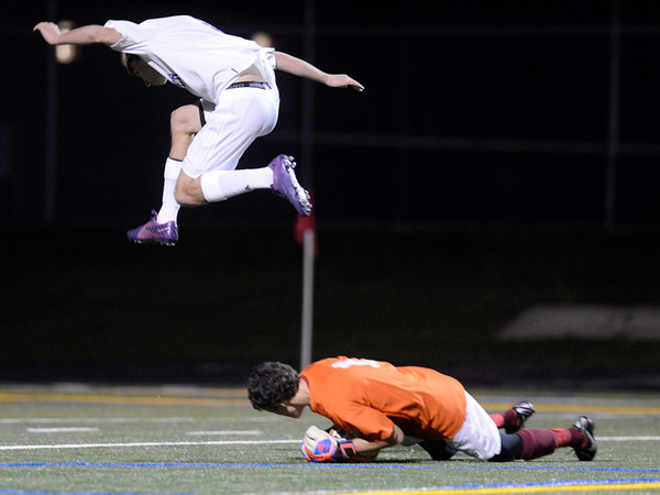 "Boulder High School's Mason Douillard flies over goalkeeper Steven Seagraves after an attempted goal during a playoff game against Chatfield High School on Monday, Oct. 29, at Recht Field in Boulder. Boulder won the game 3-2. For more photos of the game go to  <a href=""http://www.dailycamera.com"">http://www.dailycamera.com</a><br /> Jeremy Papasso/ Camera"