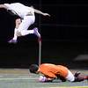"""Boulder High School's Mason Douillard flies over goalkeeper Steven Seagraves after an attempted goal during a playoff game against Chatfield High School on Monday, Oct. 29, at Recht Field in Boulder. Boulder won the game 3-2. For more photos of the game go to  <a href=""""http://www.dailycamera.com"""">http://www.dailycamera.com</a><br /> Jeremy Papasso/ Camera"""