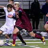 """Boulder High School's Mason Douillard fights for the ball with Lee Holmes during a playoff game against Chatfield High School on Monday, Oct. 29, at Recht Field in Boulder. Boulder won the game 3-2. For more photos of the game go to  <a href=""""http://www.dailycamera.com"""">http://www.dailycamera.com</a><br /> Jeremy Papasso/ Camera"""