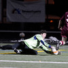 "Boulder High School goalkeeper Henry Huettel makes a save in front of Chad Hasse during a playoff game against Chatfield High School on Monday, Oct. 29, at Recht Field in Boulder. Boulder won the game 3-2. For more photos of the game go to  <a href=""http://www.dailycamera.com"">http://www.dailycamera.com</a><br /> Jeremy Papasso/ Camera"