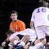 """Boulder High School players jump into a pile in front of goalkeeper Steven Seagraves after scoring the winning run during a playoff game against Chatfield High School on Monday, Oct. 29, at Recht Field in Boulder. Boulder won the game 3-2. For more photos of the game go to  <a href=""""http://www.dailycamera.com"""">http://www.dailycamera.com</a><br /> Jeremy Papasso/ Camera"""