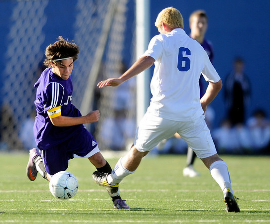 """Boulder High School junior """"Paco"""" Resendiz dribbles the ball past Cherry Creek sophomore Nick Groesser during the Class 5A State soccer semifinals against Cherry Creek on Saturday, Nov. 6, at Englewood High School. Cherry Creek defeated Boulder 2-1.<br /> For more photos go to  <a href=""""http://www.dailycamera.com"""">http://www.dailycamera.com</a><br /> Photo by JEREMY PAPASSO"""