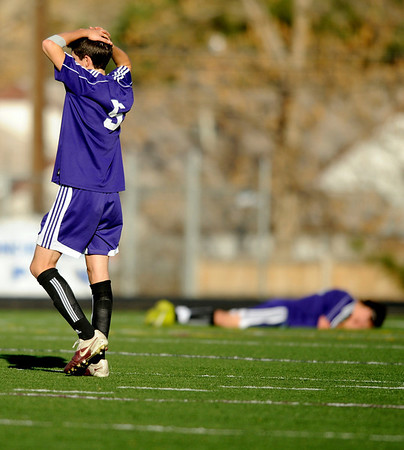 """Boulder High School senior Brooks Dipaula, left, and senior Tyler Kane show their emotion after losing to Cherry Creek in the Class 5A State soccer semifinals against Cherry Creek on Saturday, Nov. 6, at Englewood High School.<br /> For more photos go to  <a href=""""http://www.dailycamera.com"""">http://www.dailycamera.com</a><br /> Photo by JEREMY PAPASSO"""