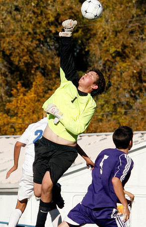 "Boulder High School senior Murray Smith makes a save during the Class 5A State soccer semifinals against Cherry Creek on Saturday, Nov. 6, at Englewood High School.<br /> For more photos go to  <a href=""http://www.dailycamera.com"">http://www.dailycamera.com</a><br /> Photo by Daniel Clements"