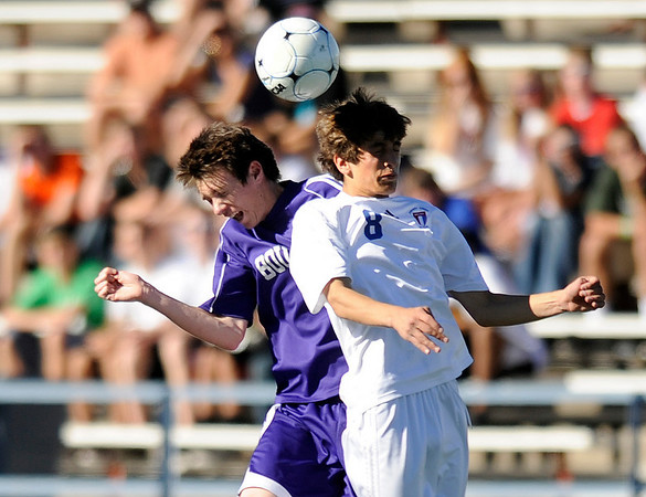 "Boulder High School senior Cole Carosella and Cherry Creek senior Joshua Alswang try to head the ball during the Class 5A State soccer semifinals against Cherry Creek on Saturday, Nov. 6, at Englewood High School. Cherry Creek defeated Boulder 2-1.<br /> For more photos go to  <a href=""http://www.dailycamera.com"">http://www.dailycamera.com</a><br /> Photo by JEREMY PAPASSO"